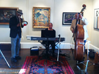 The Ed Moon Trio performs in the main gallery