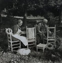 Caning Chairs Under the Trees by Bayard Wootten (1875-1959)